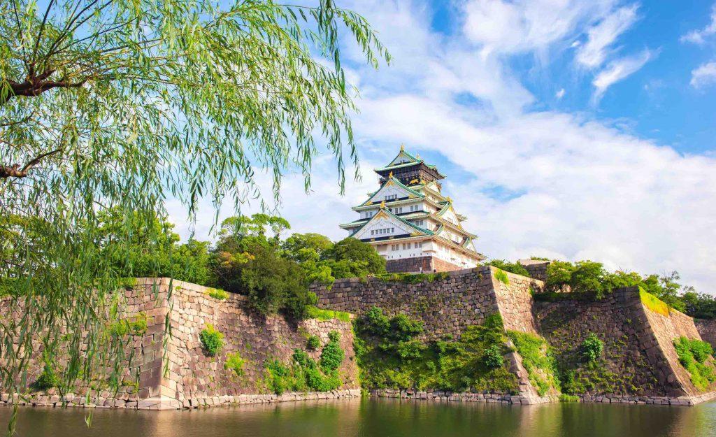 Japan - July 19, 2019 : Scenic view of Osaka Castle surrounding with small moat in Summer, Osaka Castle Park, Osaka